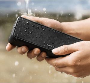 Black Wireless Speaker Under Running Water