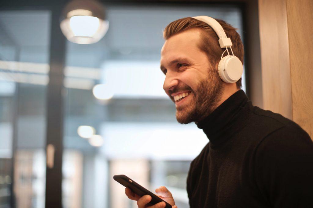 Man using on ear headphones