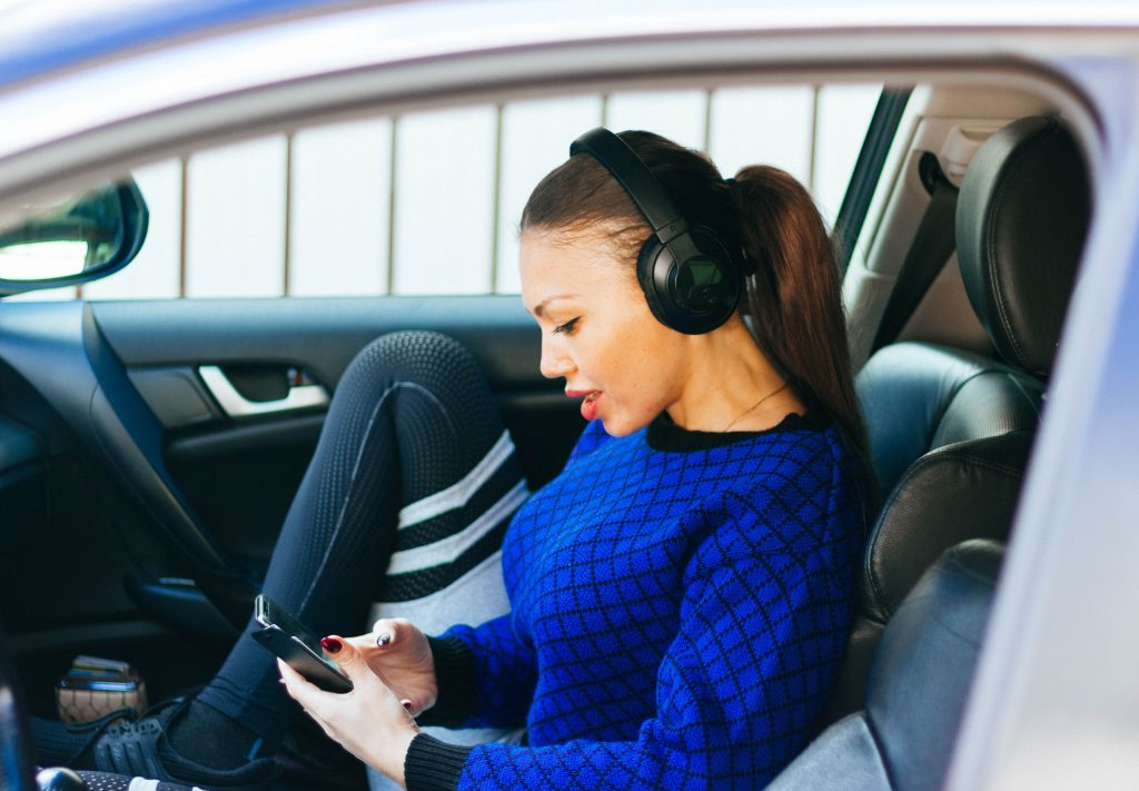 Girl listening to over the ear headphones