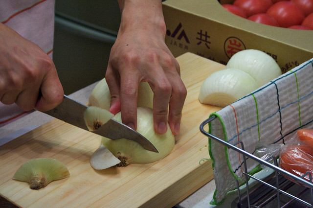 chopping onions for meal prep in singapore