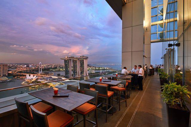 best rooftop restaurant in singapore level 33 outdoor patio evening sky