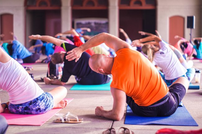 yoga practice man woman workout