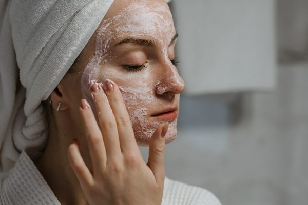 woman clay mask applying shower