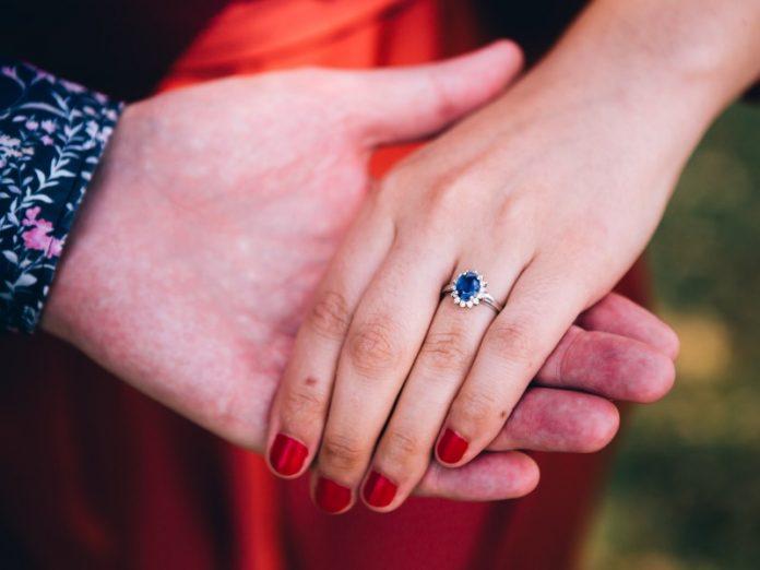 design engagement ring gemstone singapore couple hold hand proposal sapphire