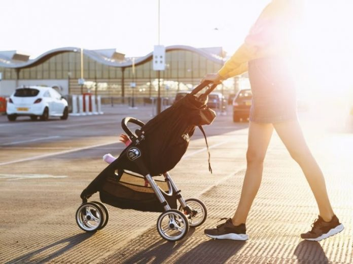 lady pushing baby stroller on the road