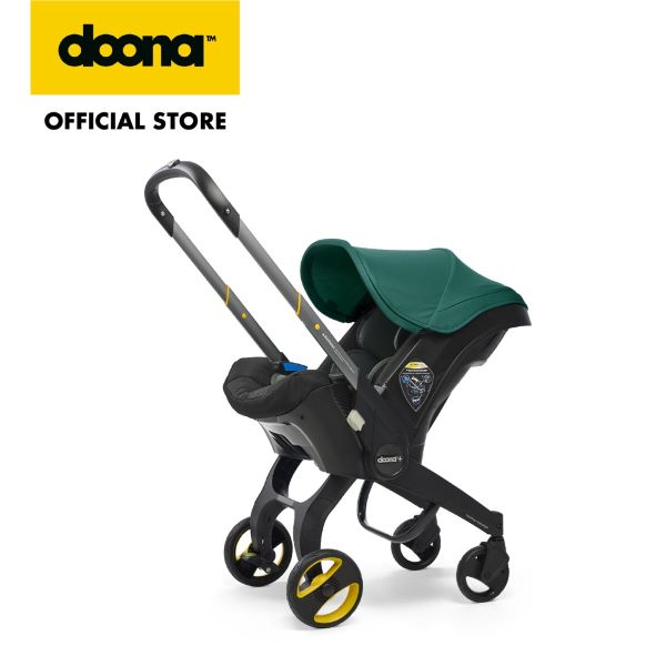 doona car seat stroller with green canopy
