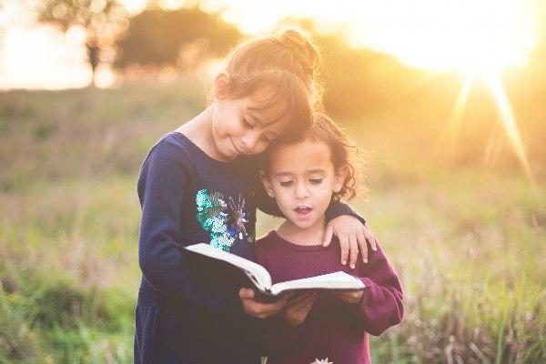 best children's book storybooks for kids two girls reading hugging