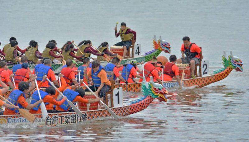 multiple dragon boats during dragon boat festival