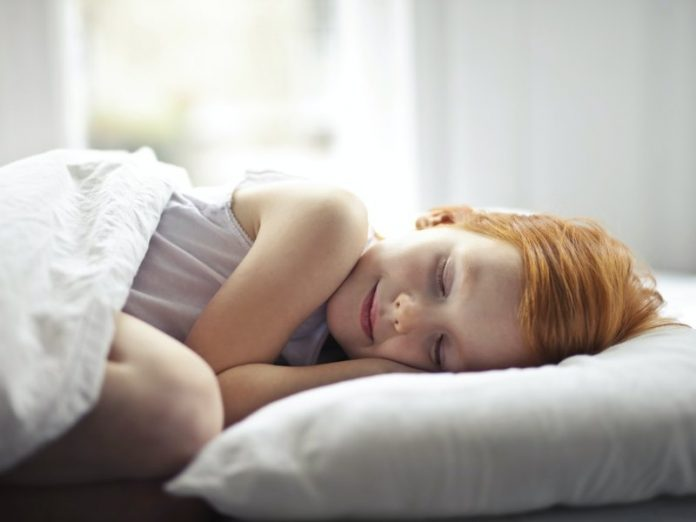 how to improve sleep quality well rested girl smiling in her sleep bed