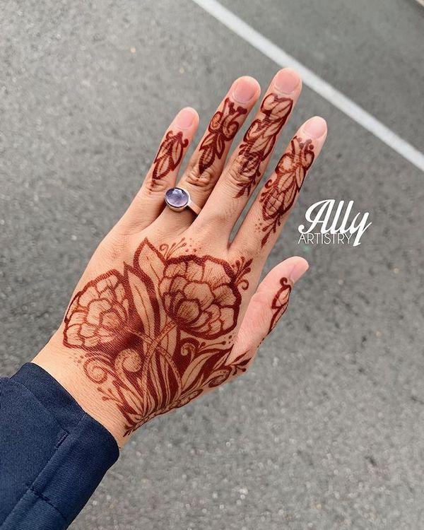 lotus henna design 2021 on back of palm