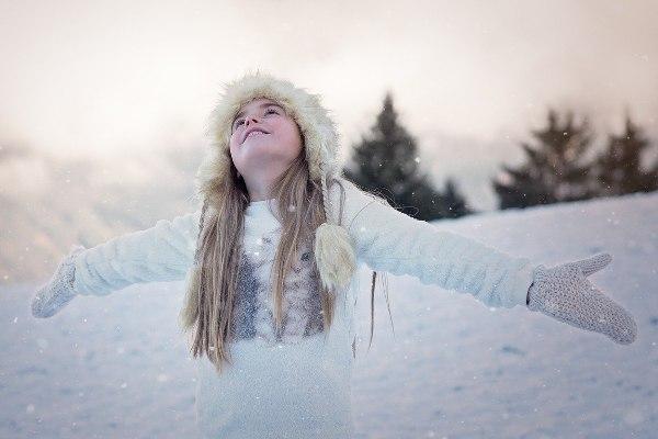 diy snow girl in winter clothes snowfall