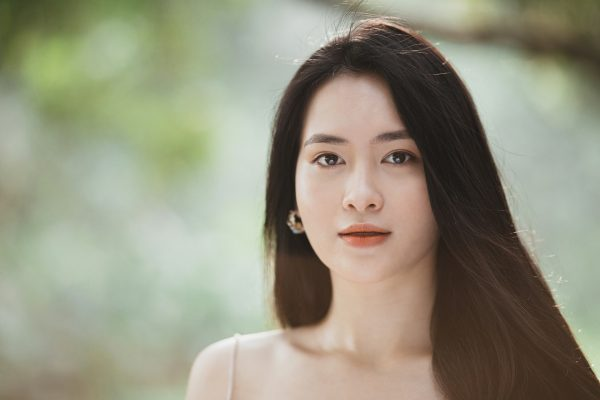 lady young woman 30s long hair pretty smile youthful complexion