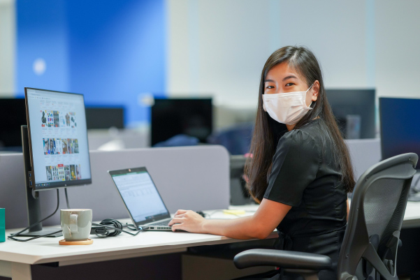 Jia Xin at her workstation
