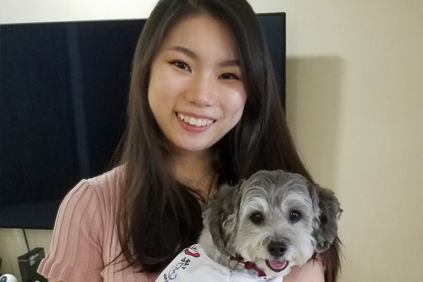 Vanessa with her toy poodle, Bailey