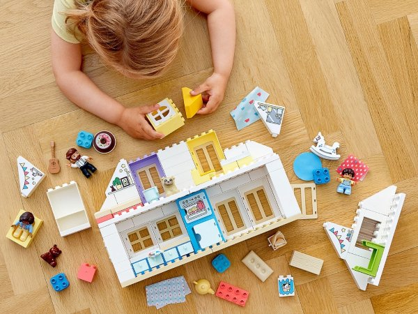 girl playing with lego duplo dollhouse set best