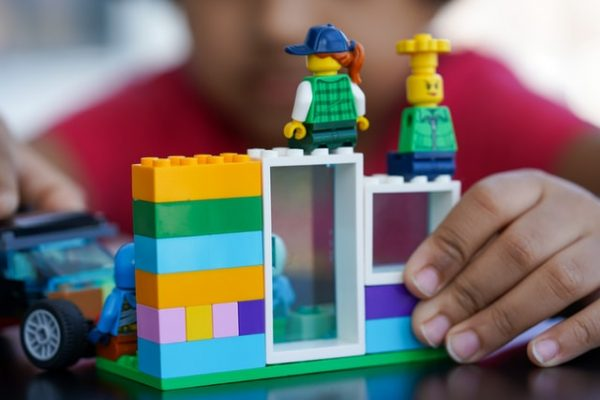 kids role playing with lego brick characters