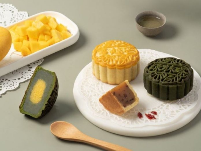 green mooncake and traditional mooncake on plate