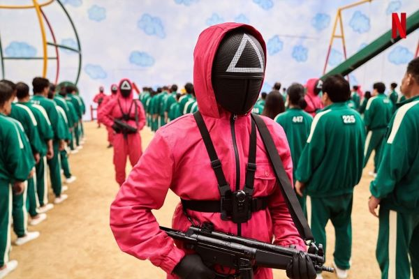 Squid Game masked men triangle pink jumpsuit