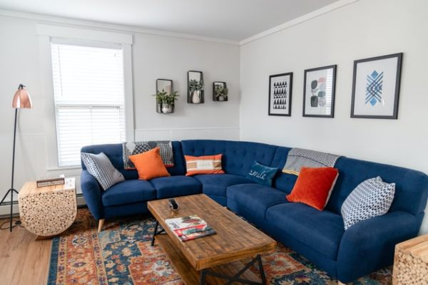 navy blue couch living room bohemian interior